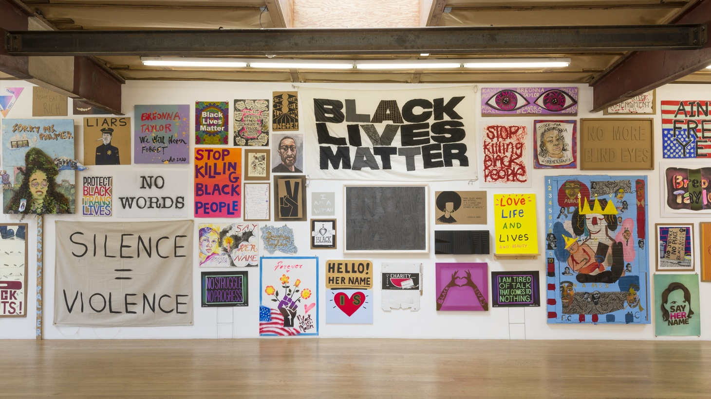"Hundreds of artists and celebrities made signs to raise funds for #SayHerName Mothers Network. ""Show Me the Signs"" Installation view, 2020 Blum & Poe, Los Angeles. Image courtesy of the artists."