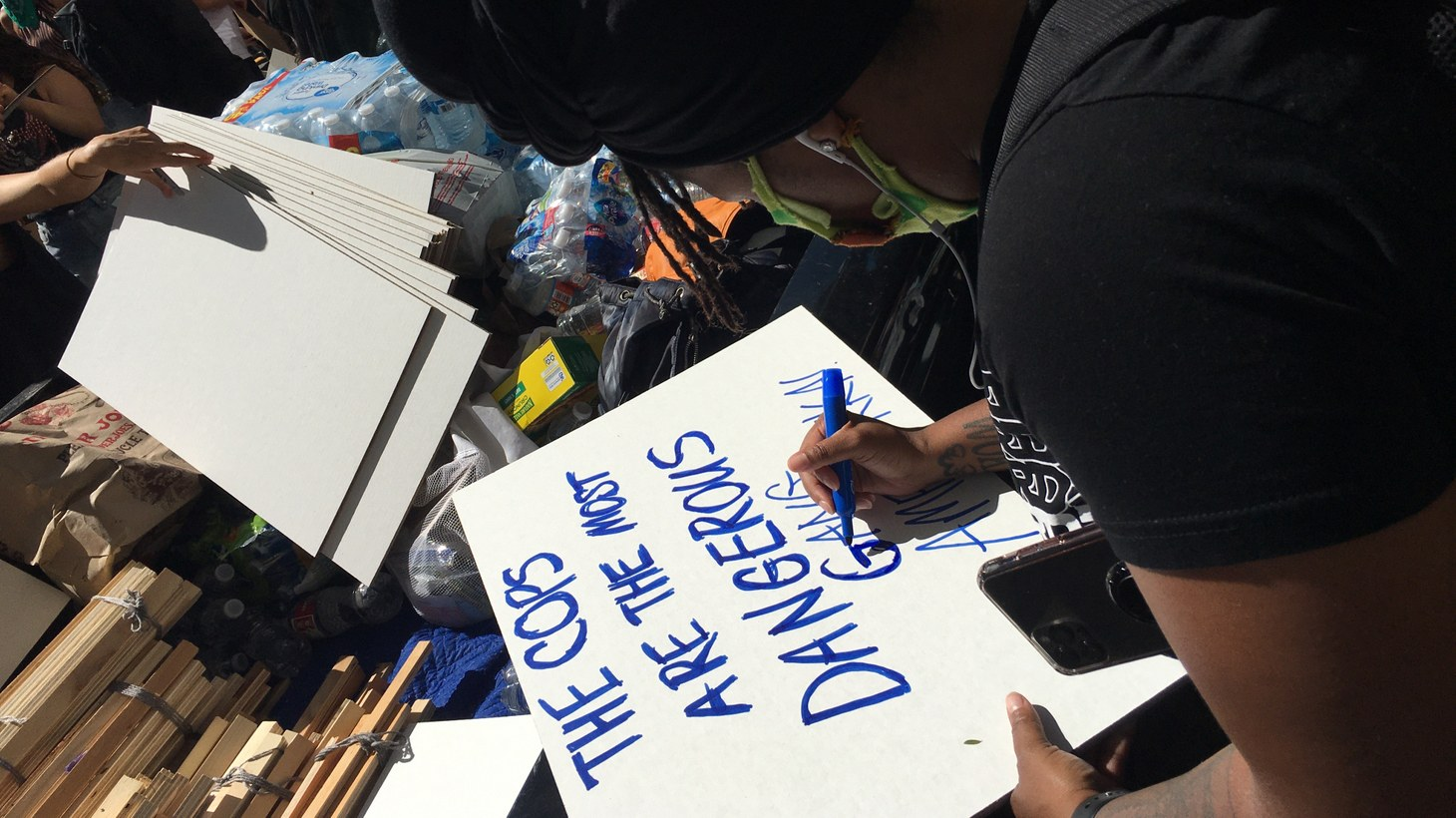 A participant makes a sign at Sunday's protest.