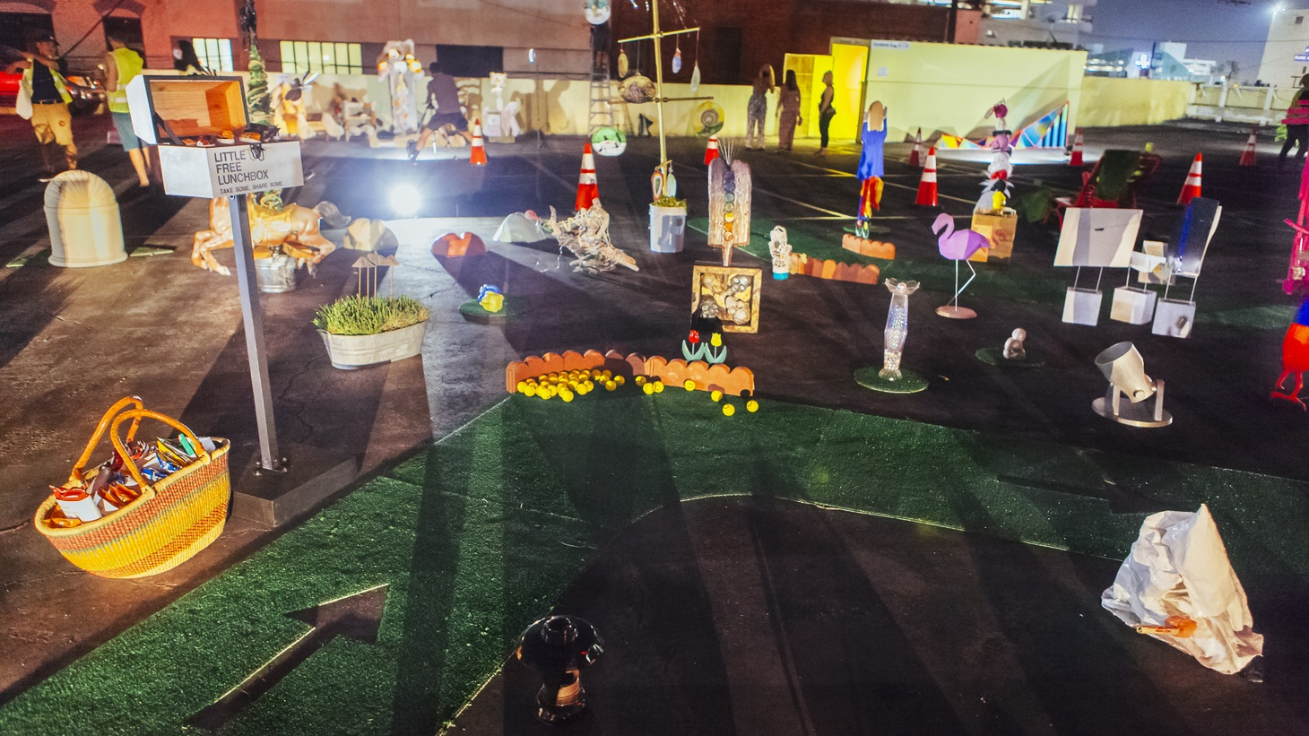 """""""High Beams"""" was a drive-through art show from Saturday night on the rooftop of a parking garage in the Fashion District downtown. It included installations from nine different art spaces and was organized as part of Maiden LA."""