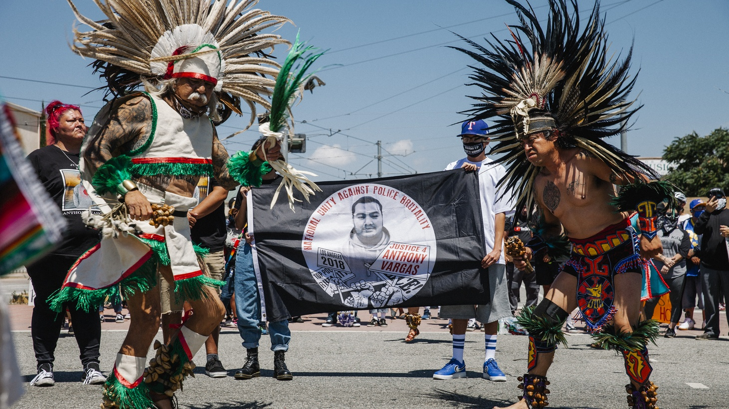 During a June 7 rally in Boyle Heights, Danzantes Aztecas surround the family of Anthony Vargas, who was killed by deputies two years ago.