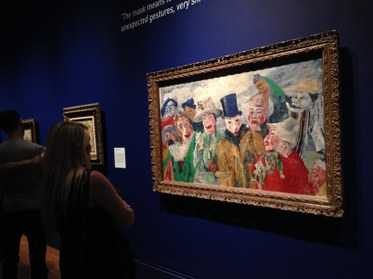"""Visitors view """"The Intrigue"""" by James Ensor, 1890. The Getty Museum.Photo by Edward Goldman."""