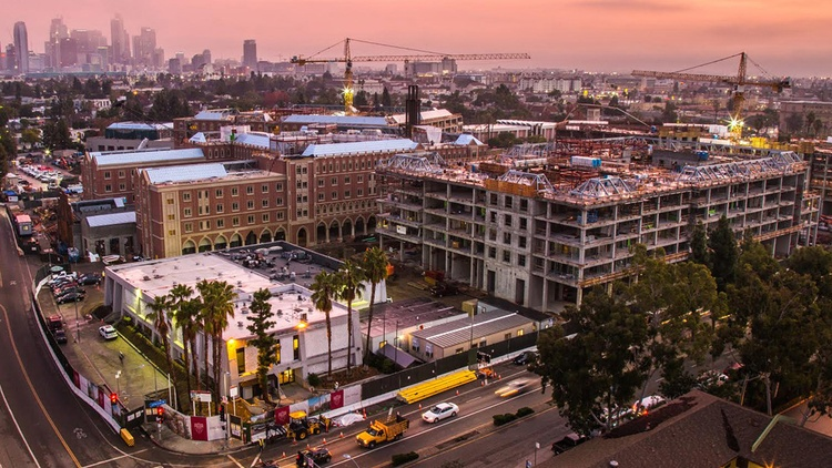 Several large developments are under construction south of the 10 Freeway, and some have initiatives to fill jobs with local, low-income workers.
