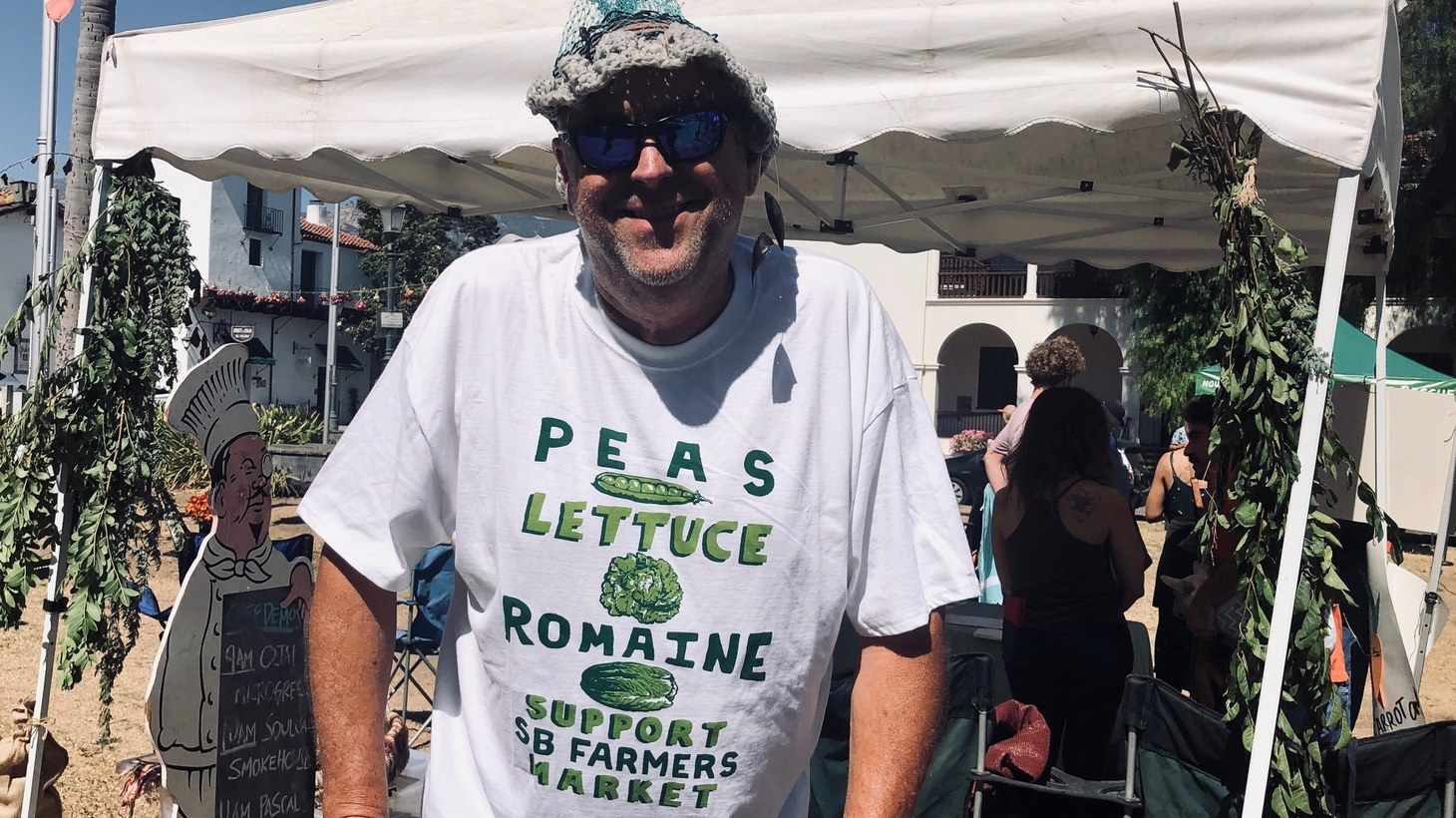 Chris Schemet (pictured) sells mussels at the Saturday morning Farmer's Market. He rallied with others at De La Guerra Plaza to oppose building the police station at the Cota Street location.