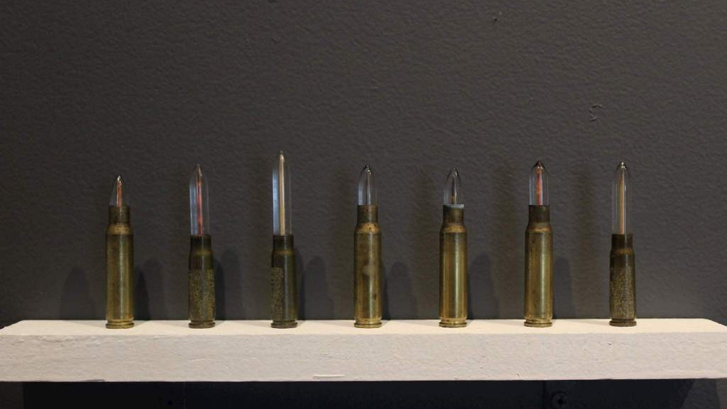"""Bernice Akamine, Papahonumoku, 2018 Spent bullet casings, glass and ʻalaea, Hawaiian earth pigments. Niihau: 1.1cm x 6.8cm x 1.1cm  """"While the artwork speaks of the desecration of sacred, burial and historic Hawaiian sites and of Native Hawaiian rights, on a larger scale it is a look at the pollution of land and sea across the US."""""""