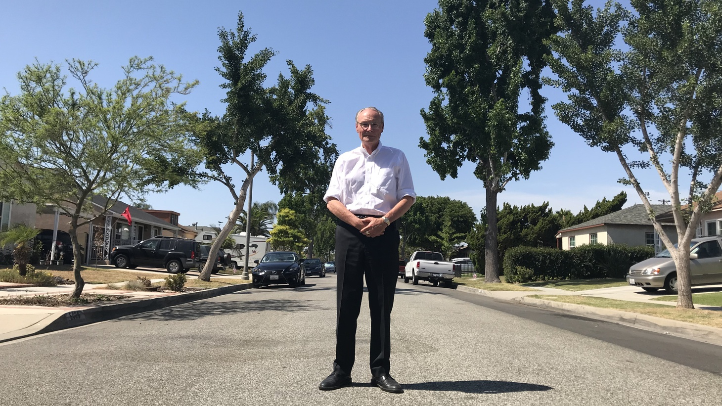 "D.J. Waldie, author of ""Becoming Los Angeles: Myth, Memory and a Sense of Place,"" stands on a street in the City of Lakewood."
