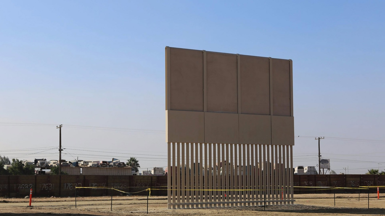 This is one of the three border wall prototypes constructed that people are able  to see through because at least the bottom half is made of spaced steel bars.  Photo by Jenny Hamel/KCRW.