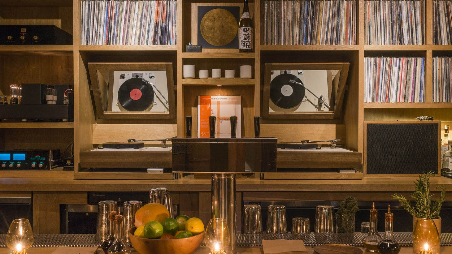 Instead of a wall of alcohol bottles, the bar In Sheep's Clothing proudly shows off its vinyl collection.