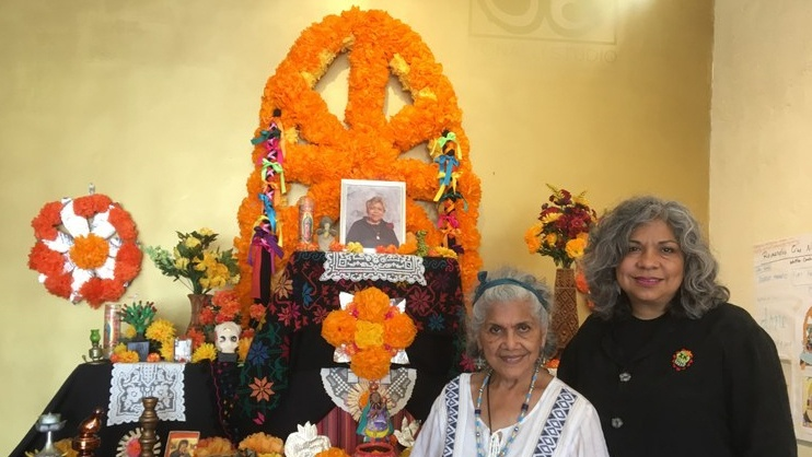 Ofelia Esparza and her daughter Rosanna Esparza Ahrens in front of an ofrenda they are designing in their East LA studio.