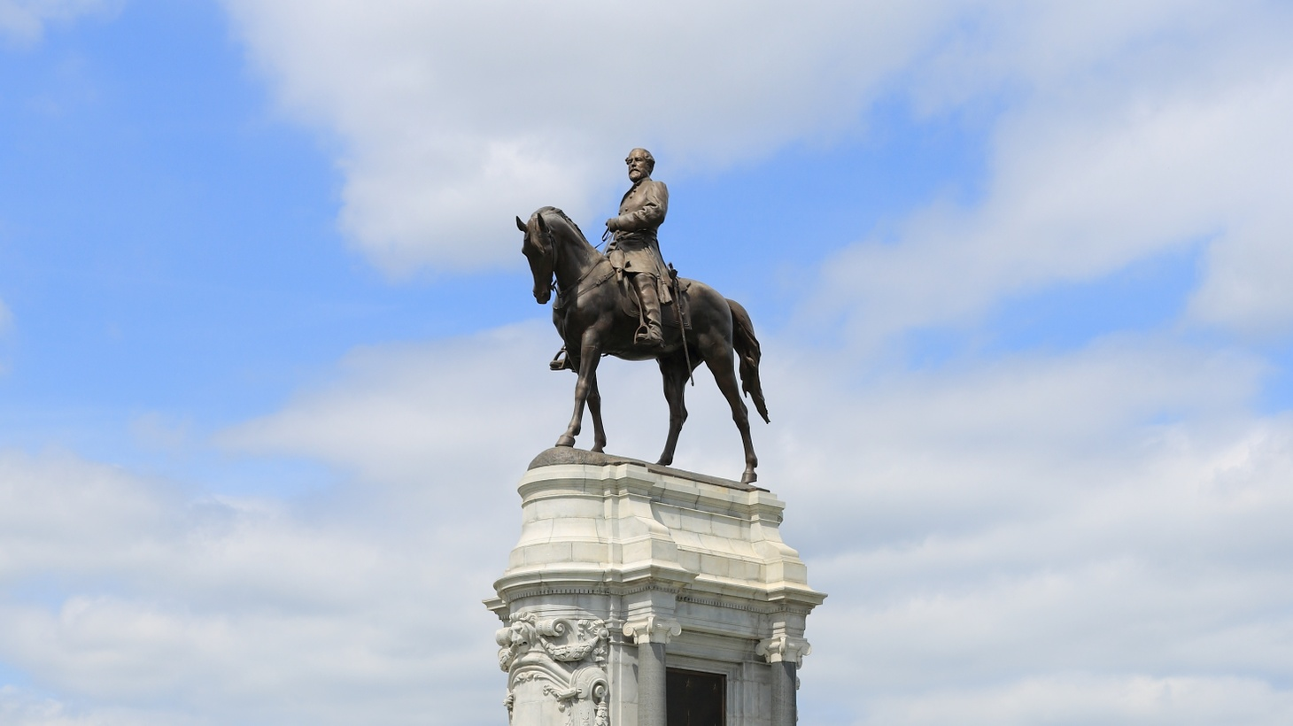 The statue of Robert E. Lee, sculpted in France by Antonin Mercié and unveiled in 1890, is the crowning glory of Monument Avenue in Richmond, Virginia. This image was taken in 2013. Now the statue is spray painted with messages of protest, and the State Gov. Ralph Northam has promised to take it down.