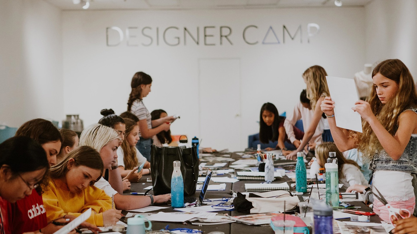 Girls work on their group projects at Designer Camp Photo by Sarah Shreves   Thousands of kids are at camp for the summer. And many will be horseback riding, making crafts and singing around the campfire. But what about a camp for kids who dream of having their own fashion or interior design empire? DnA producer Avishay Artsy went to the Big…