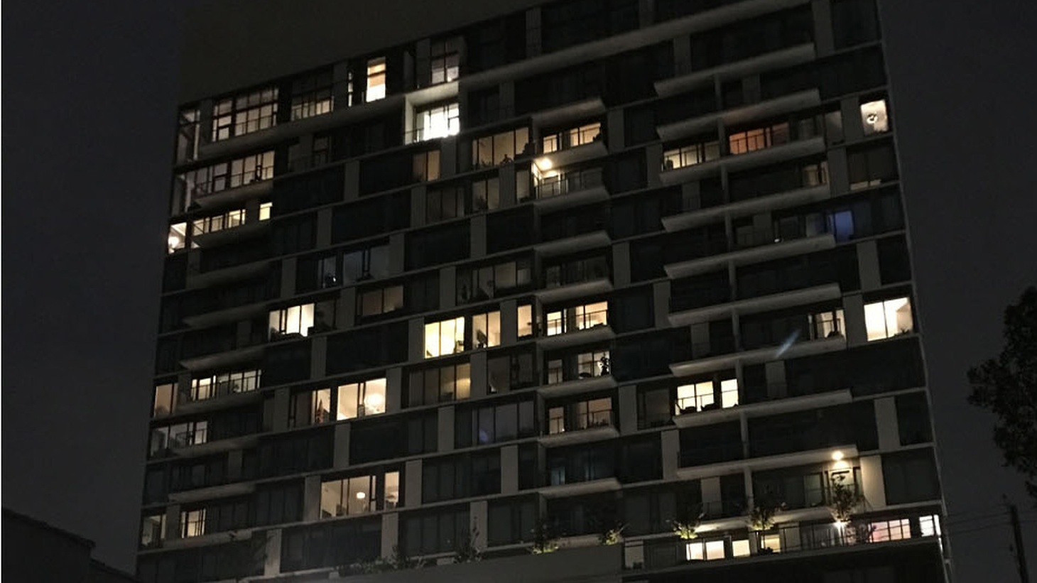 Few lights are on at the Vision, an 18-story high-rise in West LA, suggesting to some that it may have a number of vacant units.