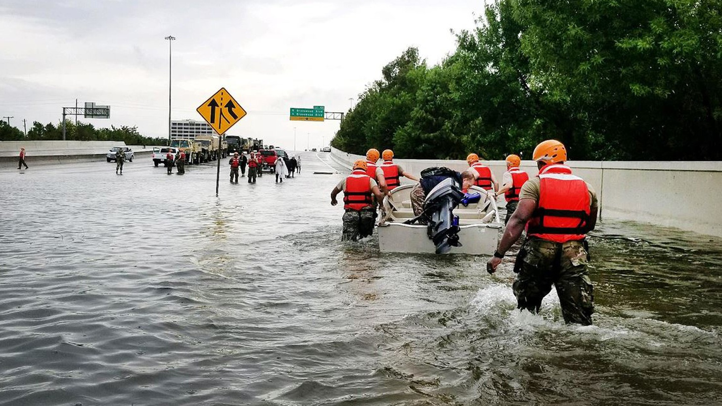 Texas National Guardsmen rescue a resident by boat during flooding caused by Hurricane Harvey in Houston.
