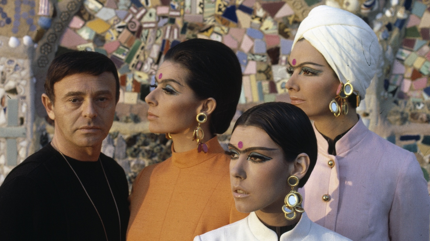 Rudi Gernreich with models wearing his designs in front of Watts Towers, c. 1965.
