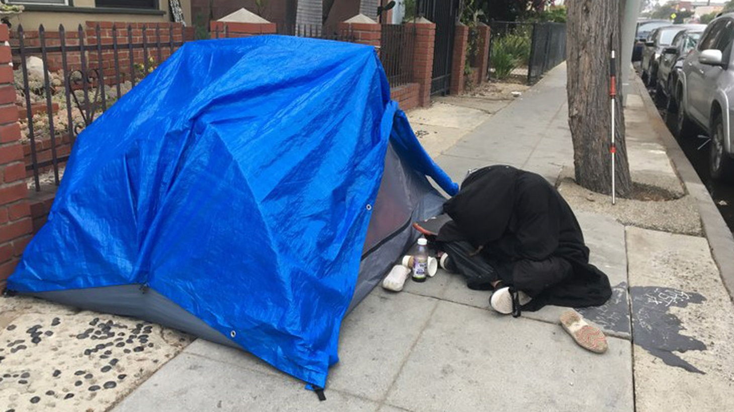 A modern dome tent covered with a tarp in Venice.