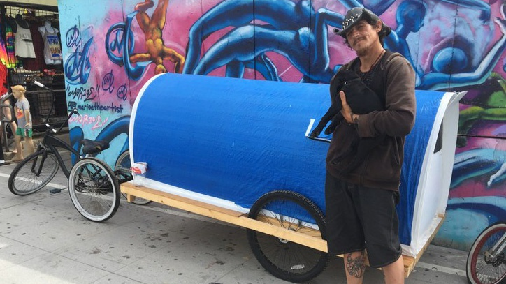 Clifford Moore with his mobile camper on the Venice Boardwalk.