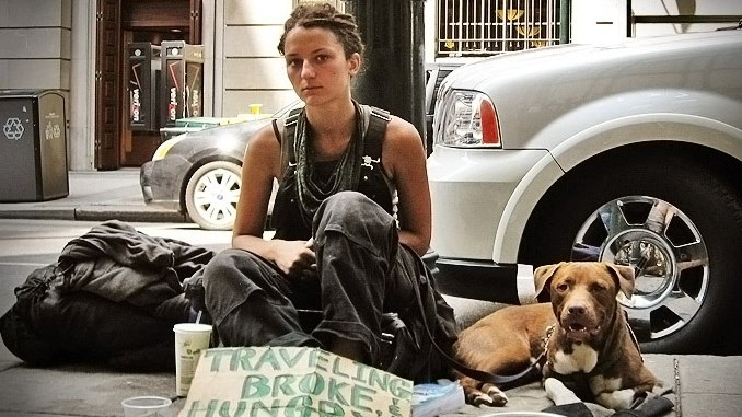 A young woman has only her dog for company while living on the street.