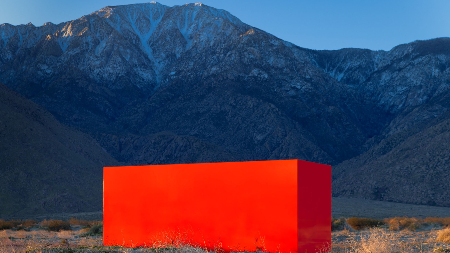 """Sterling Ruby's """"Specter"""" is a bright orange aluminum box that is drawing art pilgrims to the desert."""