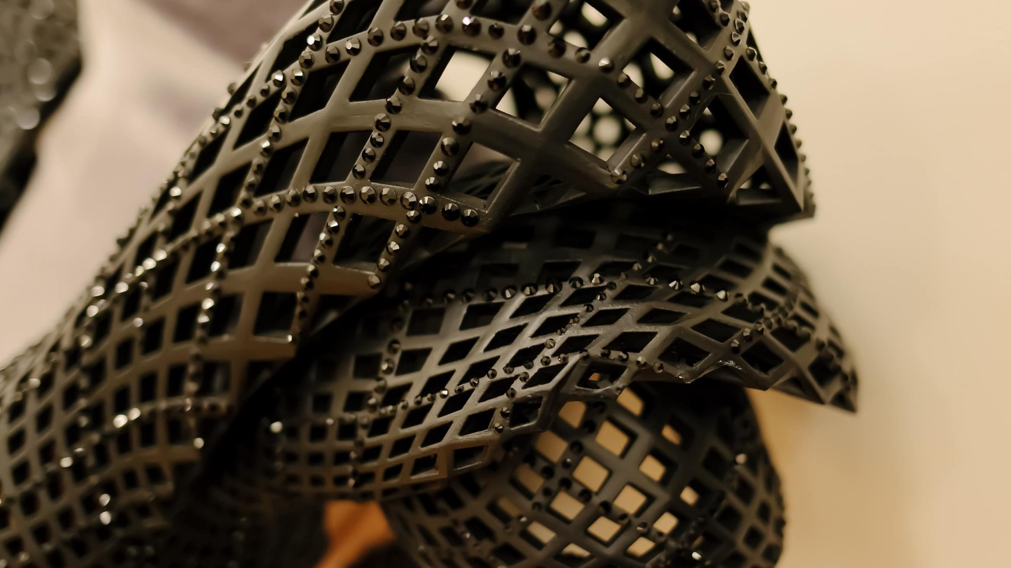 Michael Schmidt has made dresses from Legos and razor blades. Now he is testing 3-D printed plastic. Rose Apodaca talks to the designer about his amazing costumes.