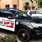 Police cars in Laguna Beach will keep their new American flag logos