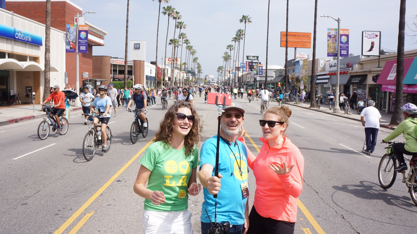 Aaron Paley at the fourth cicLAvia, in San Fernando Valley in 2015, with Emily Munroe (left) and Alyssa Bird (right).