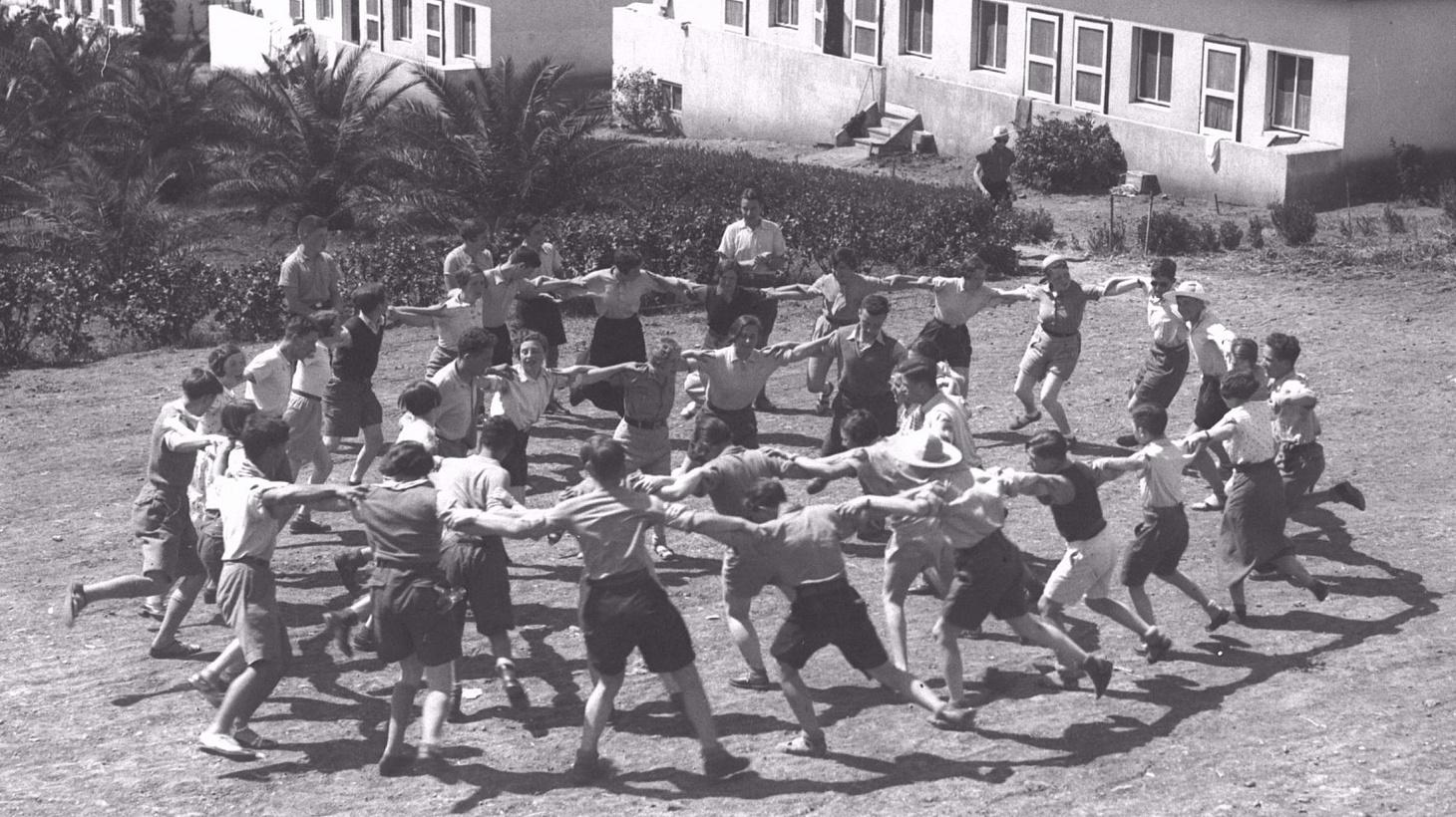 Youth Aliya members from Germany dancing the hora at Kibbutz Ein Harod, 1936.