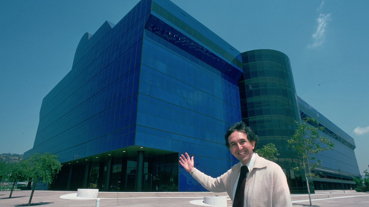 "César Pelli with the newly-built Pacific Design Center's blue building, nicknamed ""The Blue Whale."""