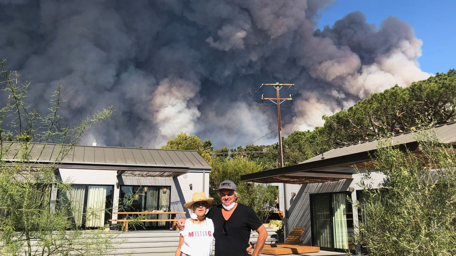 The Woolsey Fire barrels towards the home of Claudia and Rob Taylor. This newly completed guesthouse survived; it has a metal roof, concrete structure and no eaves, all recommended in fire zones. Will new structures in Malibu follow suit?
