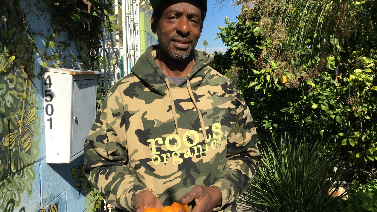 """South LA's """"Gangsta Gardener"""" has won out. Ron Finley, a community gardener and activist for healthy food in underserved neighborhoods, has managed to overcome a threat of eviction after successfully buying his property from an Agoura Hills developer."""