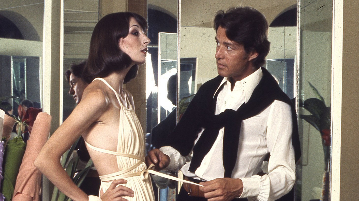 Anjelica Huston being fitted by Halston.