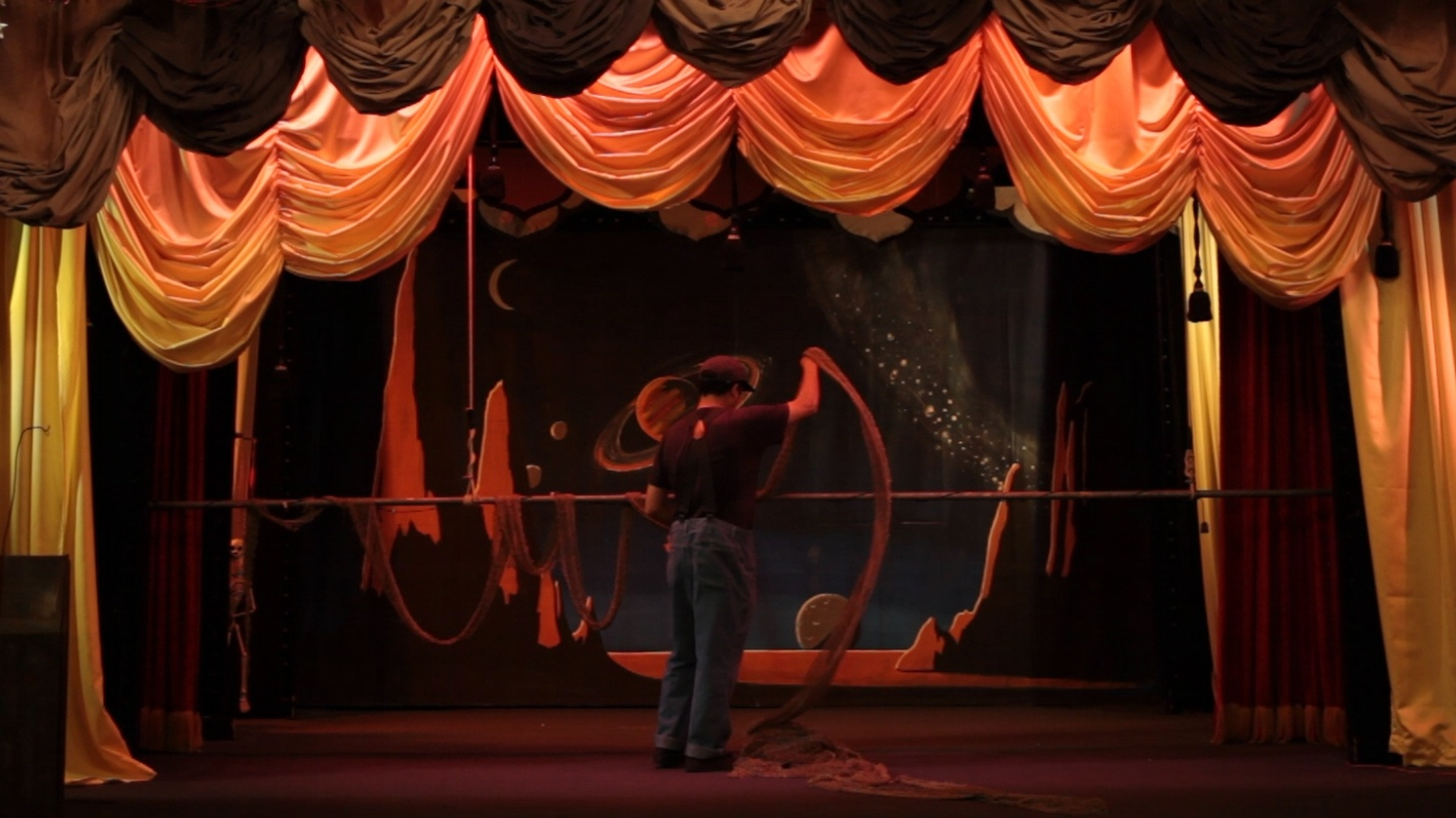 Miguel Ayala adjusts a backdrop at the Bob Baker Marionette Theater.