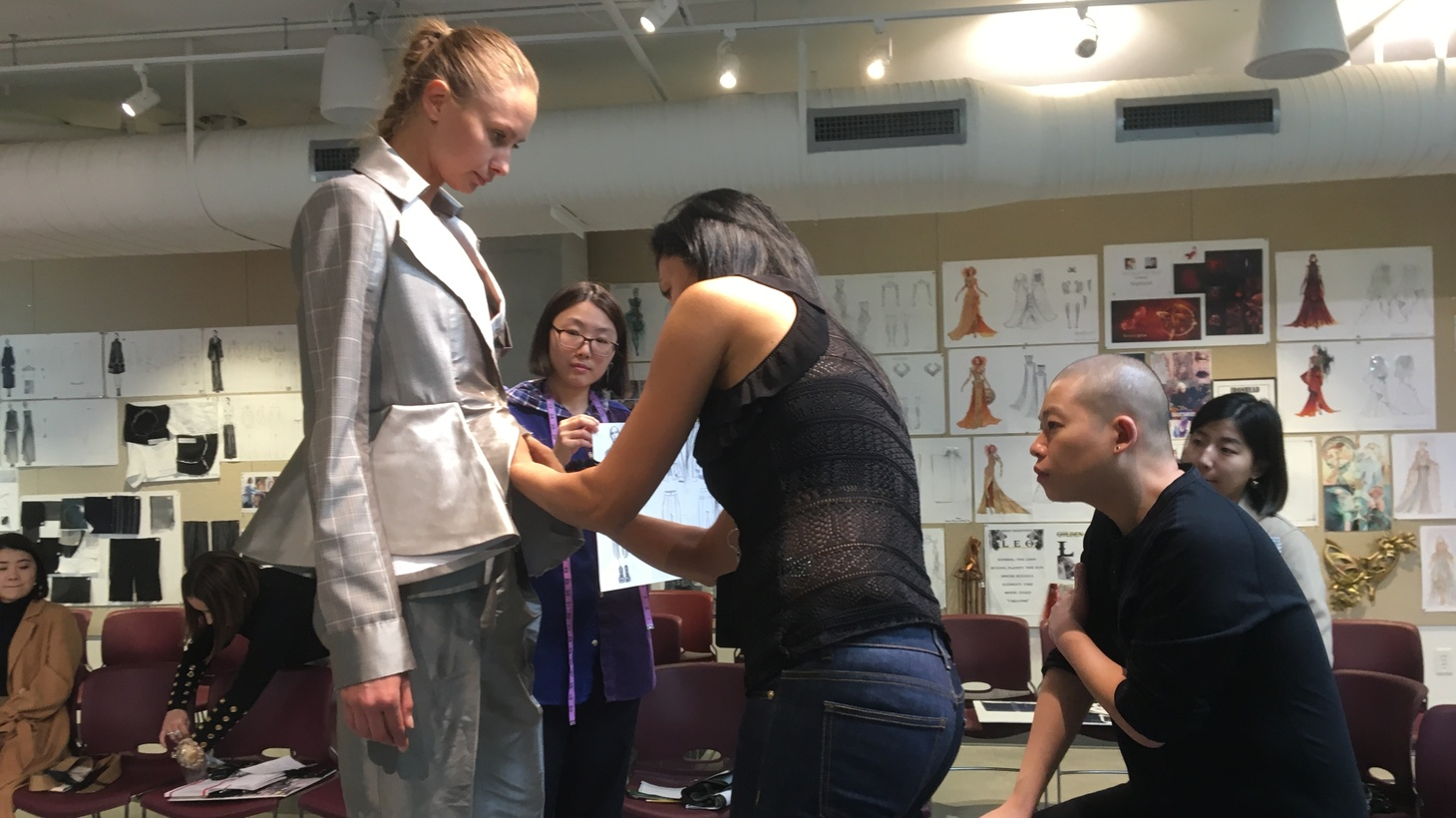 Jason Wu mentors Otis fashion students as they prepare a collection of women's outfits inspired by uniforms of the 1950s.