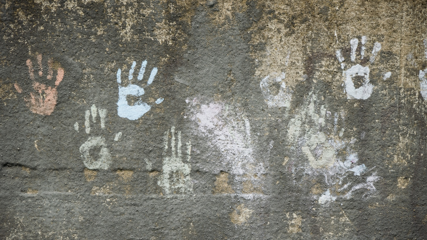 """Children's handprints on The Detroit Wall. On view as part of the exhibition """"W
