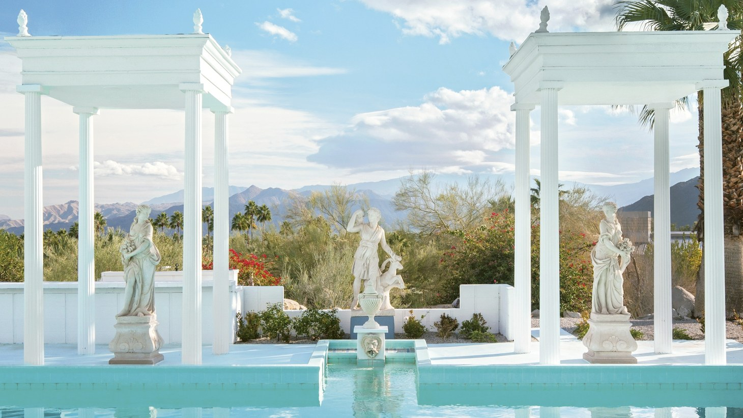 The style of the 1962 George Randolph Hearst pool in Palm Springs was influenced by the Neptune Pool at his father's legendary estate, San Simeon, and even includes statues gifted from San Simeon.