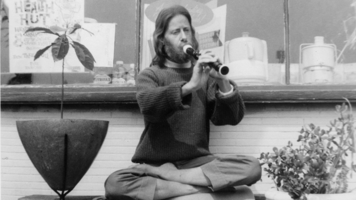 Eden Ahbez playing flute at Gypsy Boots' Health Hut, circa 1958.
