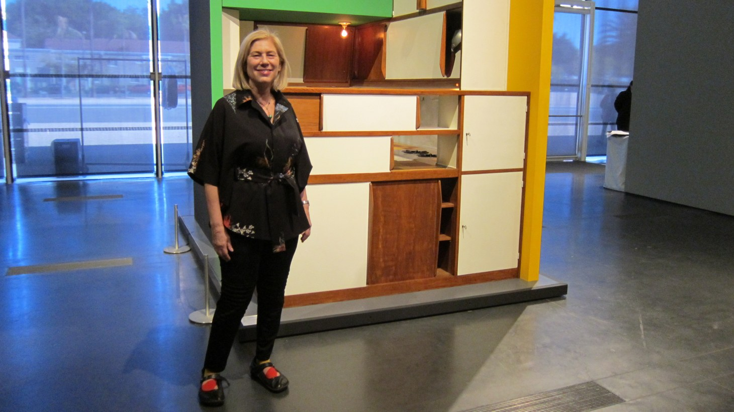 LACMA curator Wendy Kaplan poses with the Charlotte Perriand-designed kitchen.