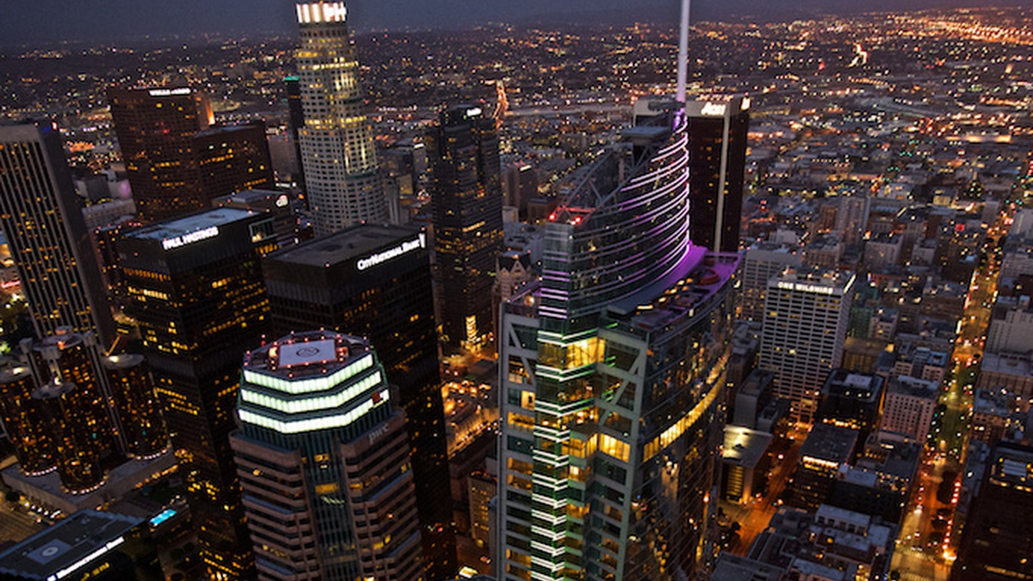 The tallest building west of the Mississippi River will officially open for business on Friday. The Wilshire Grand Center has been years in the making. It rises 73 stories, or 1,100 feet with its spire at the top, and includes a near-900 room InterContinental Hotel. And its architecture tells the story of a changing Los Angeles.
