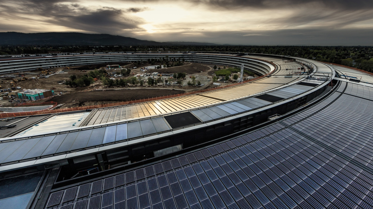 What's one mile around, has a four-story glass door, and looks like a spaceship? DnA gets a tour of Apple's new headquarters in Cupertino. And we learn about Los Angeles' creative economy, and why LA is a hotbed for manufacturing.