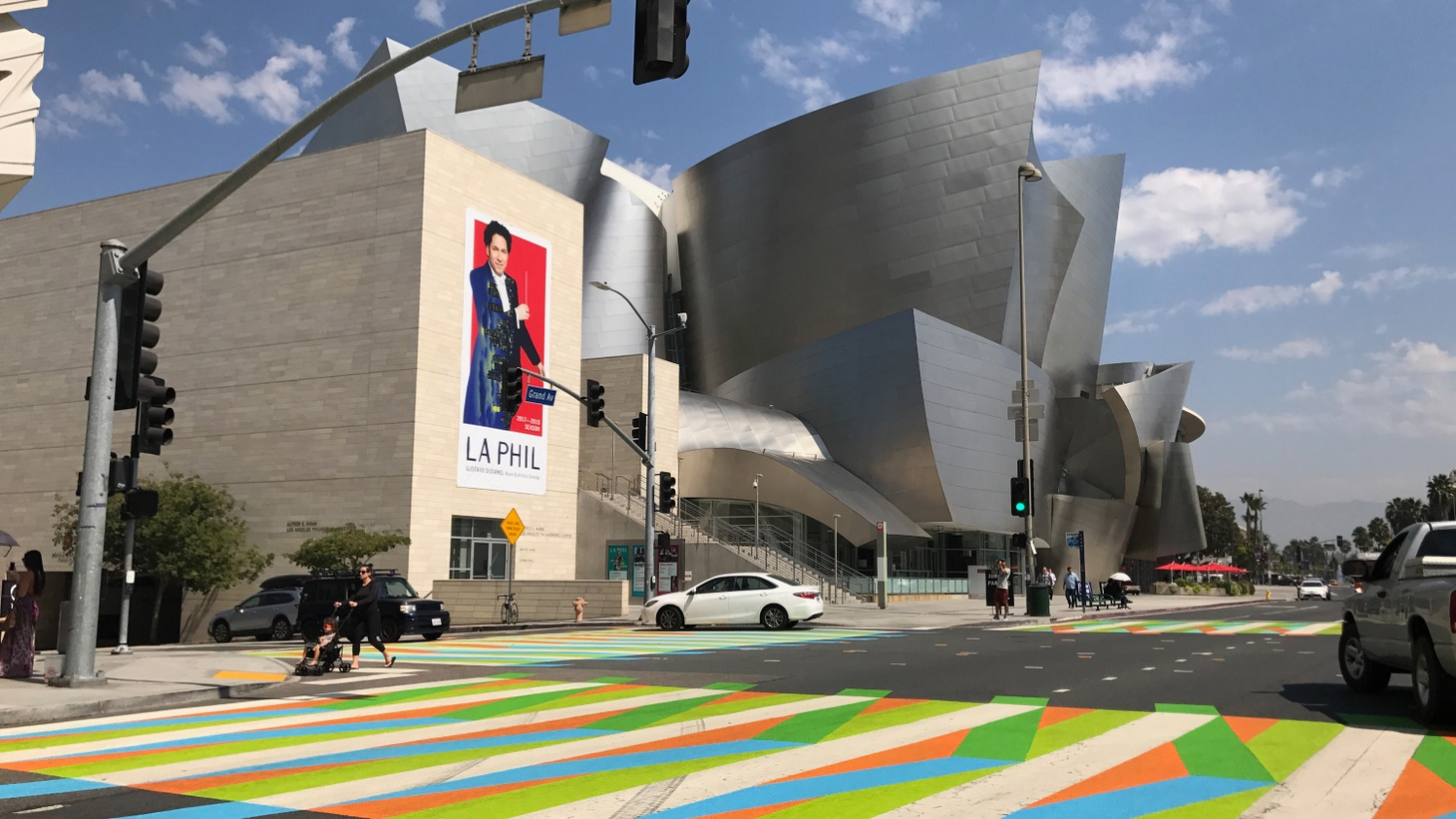 Four crosswalks in front of the Broad in downtown Los Angeles got a colorful paint job this weekend. Local high school students helped paint intersecting diagonal stripes in a design created by 94-year-old Venezuelan artist Carlos Cruz-Diez. The Broad invited him to re-imagine the crosswalks as part of the city-wide Pacific Standard Time: LA/LA.