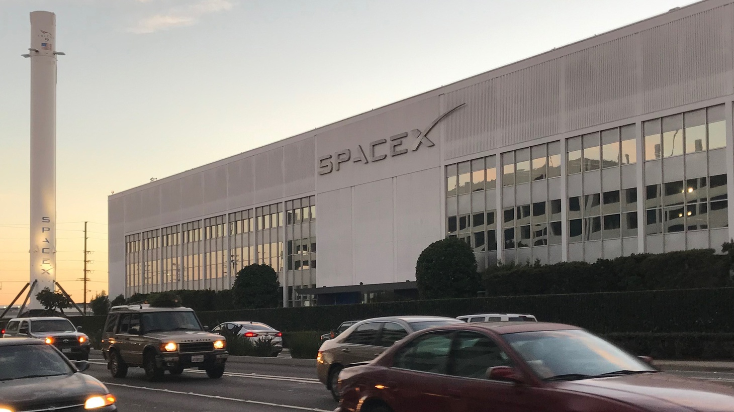 Reaching for the skies. From the Boring Company lot you can see the SpaceX Falcon 9 rocket.