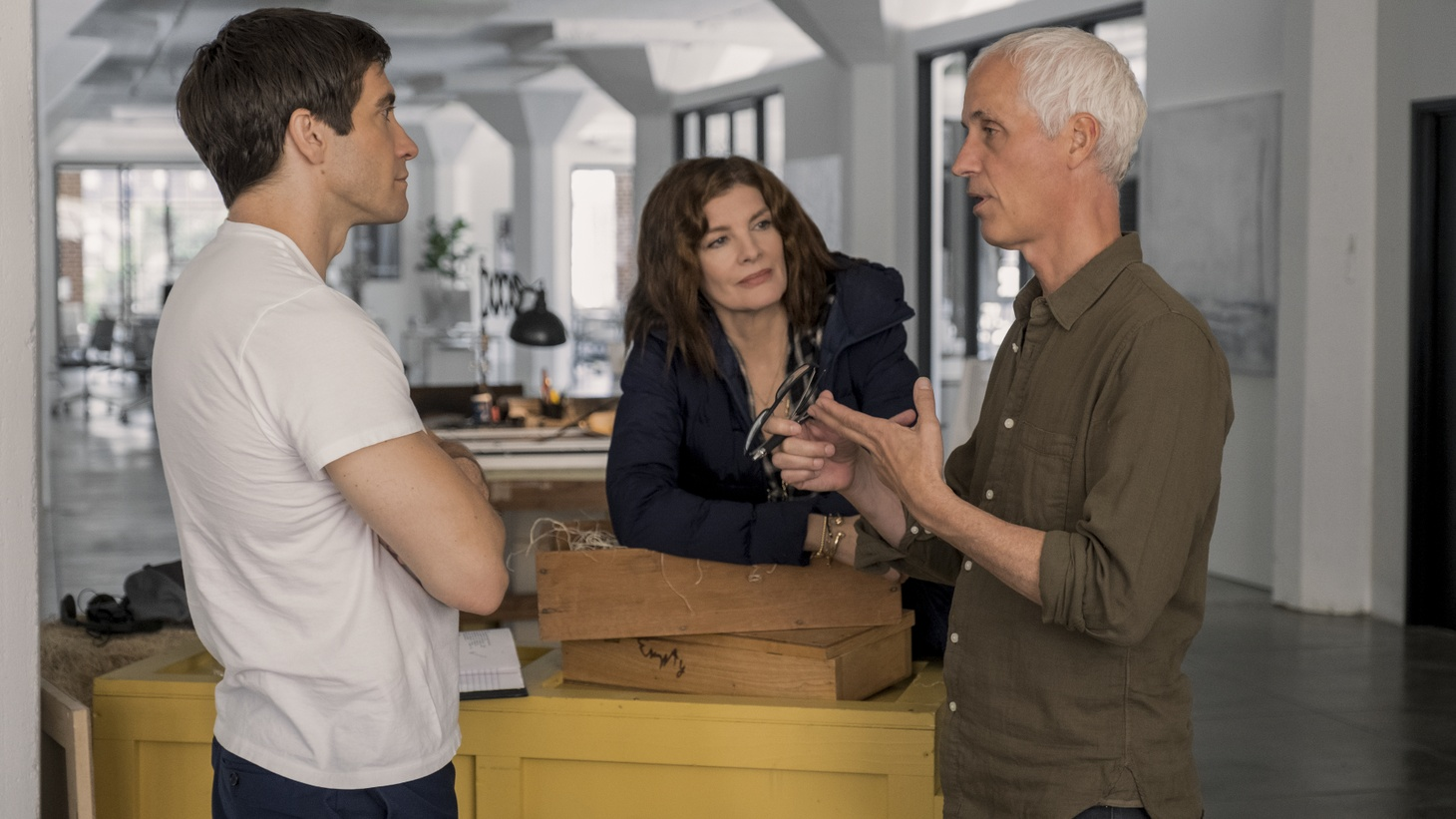 "Director Dan Gilroy talks to Jake Gyllenhaal and Rene Russo on the set of ""Velvet Buzzsaw."""