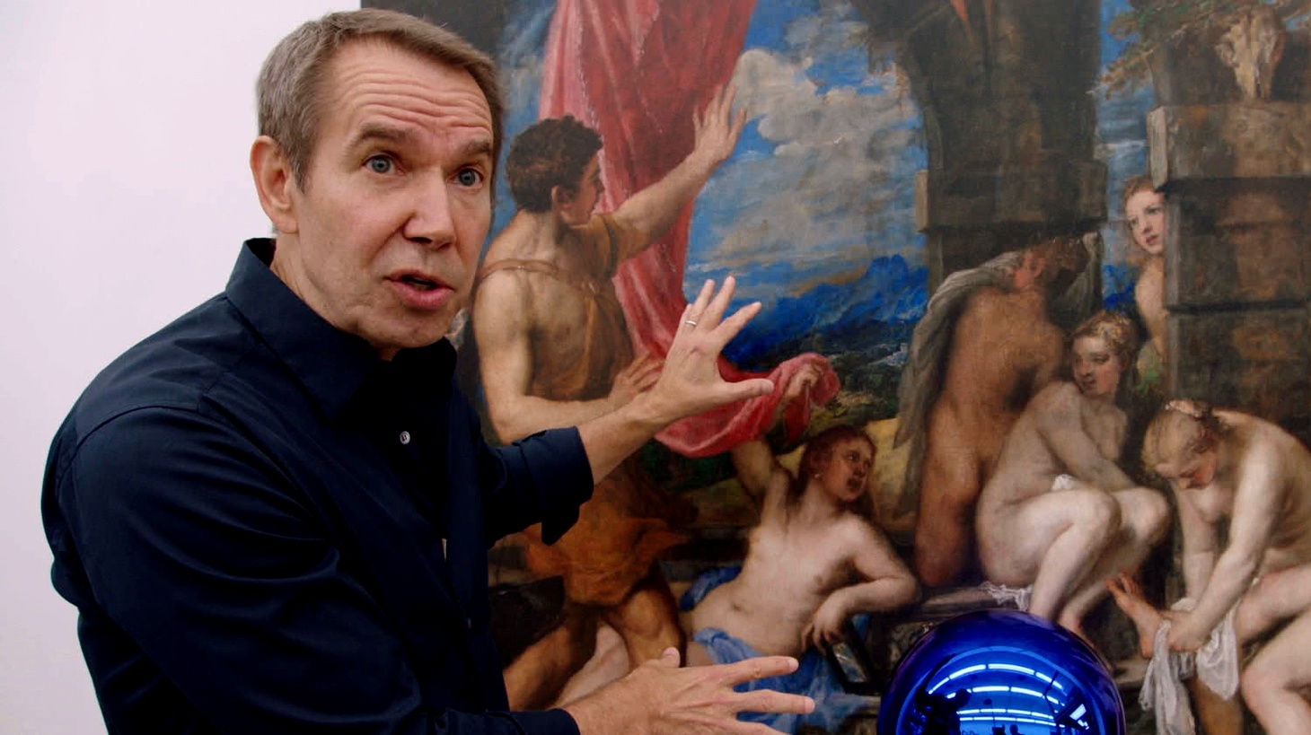 "Jeff Koons and a painting from his ""Gazing Ball"" series."