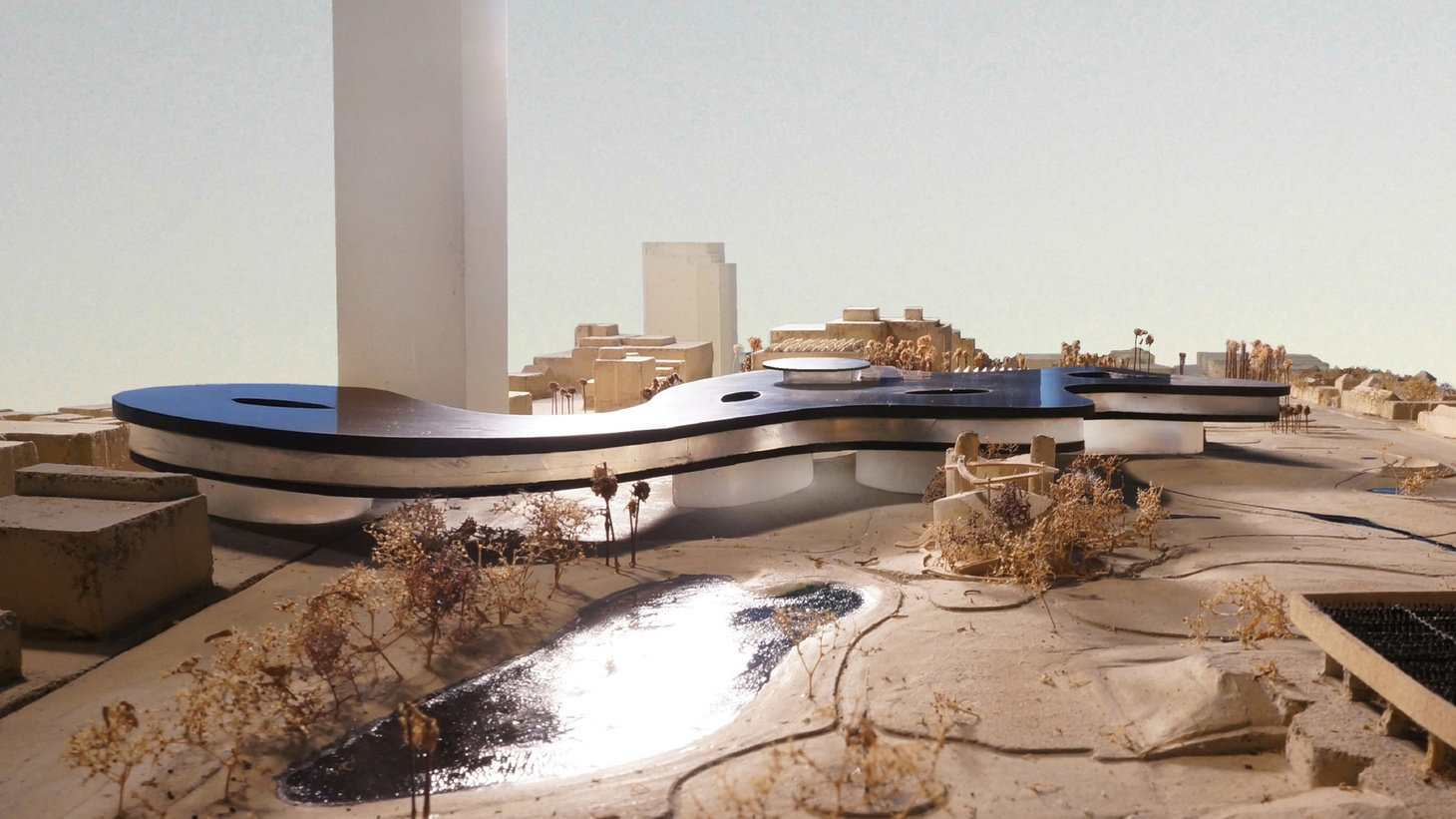 """The Los Angeles County Museum of Art is moving forward with a plan to replace four buildings on its campus with a new building designed by Swiss architect Peter Zumthor. Critics say the building is dark, monolithic, and would disrupt the flow of Wilshire Boulevard. Others describe it as """"restrained"""" and """"calm"""" and a good fit for an institution like LACMA."""