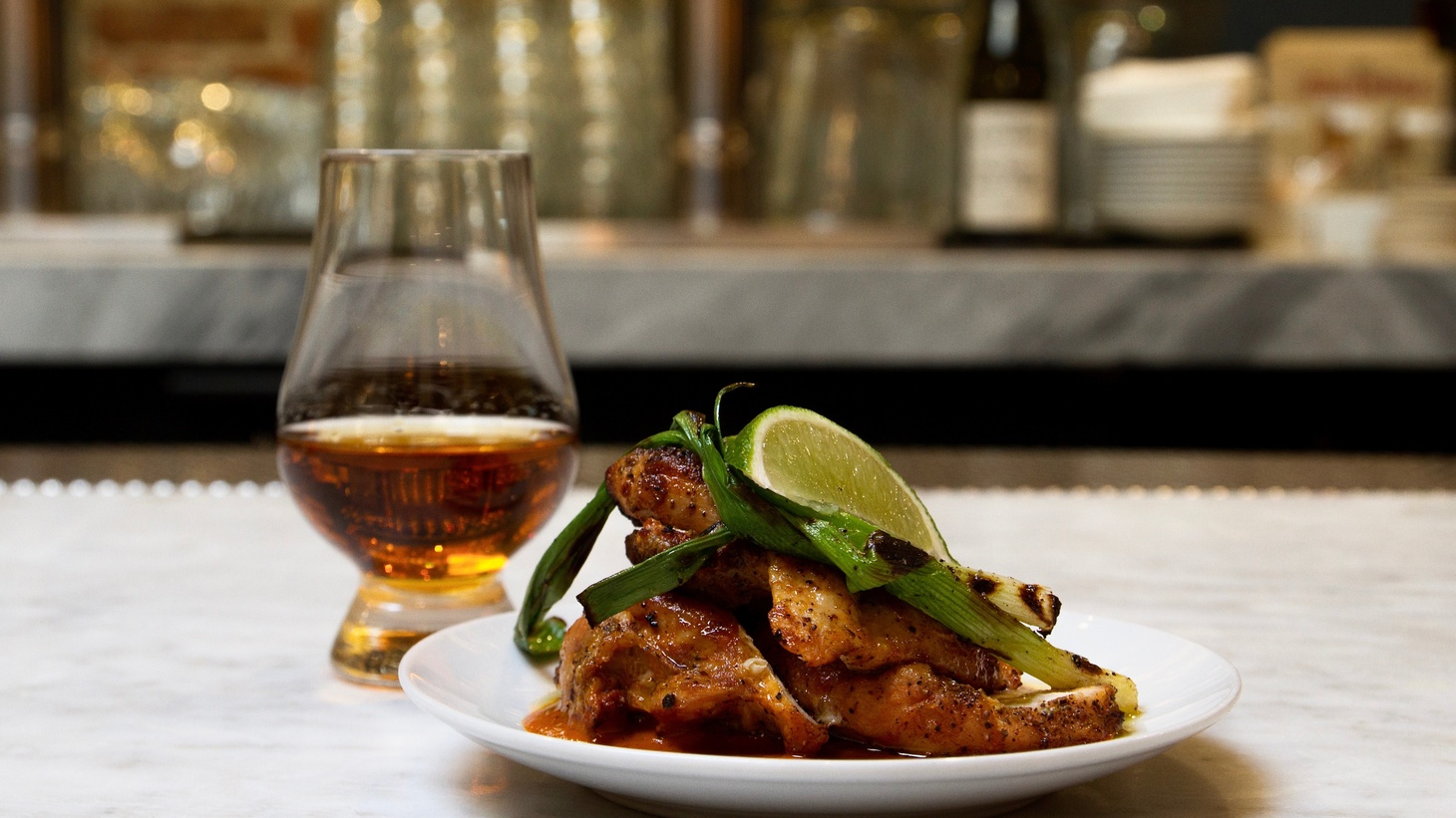 """LA Times food critic Jonathan Gold says nothing goes better with the """"extraordinarily good bourbon collection"""" at the Everson Royce Bar than Chef Matt Molina's hot buttermilk biscuits."""