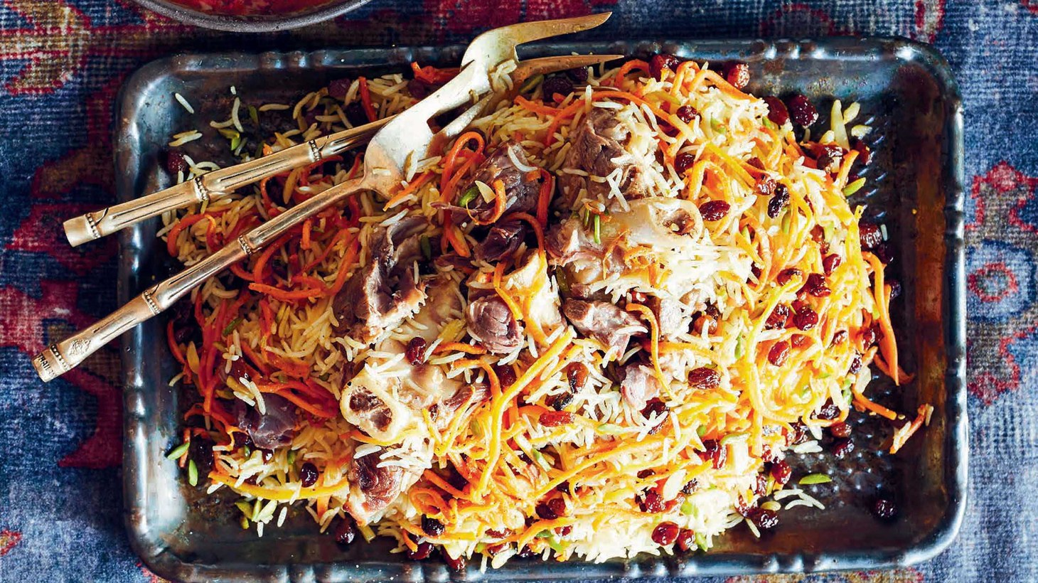 Rice is the centerpiece to Afghan cuisine around which meat, curries, salad, and dumplings are served.
