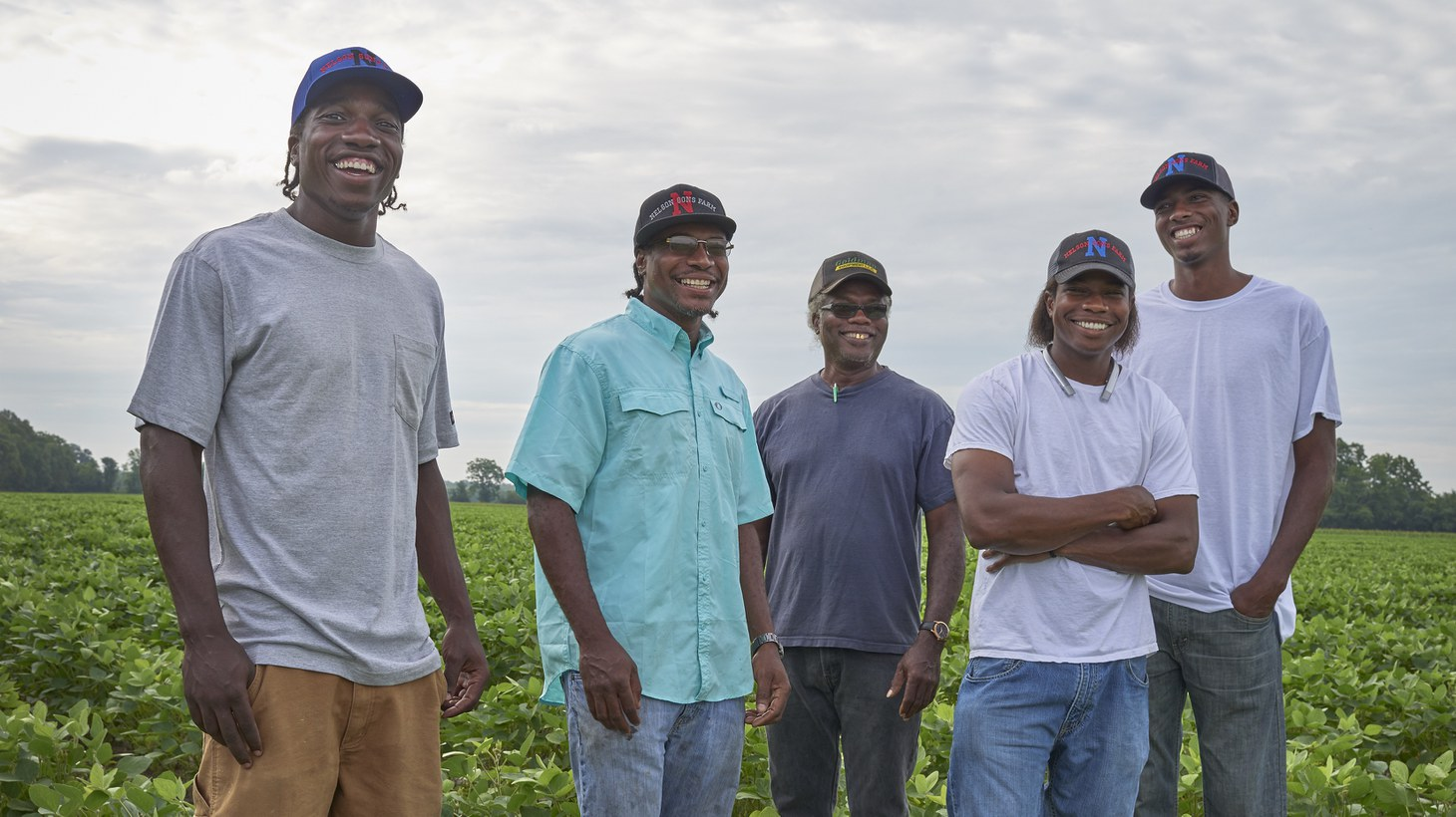 Willie Earl Nelson Sr. (center) and his sons Courtney, Willie Jr., Adrain, and Shaun are farmers in Sondheimer, Louisiana. Mr. Nelson and his son Adrain describe the discrimination and red tape many Black farmers face when obtaining loans for land.