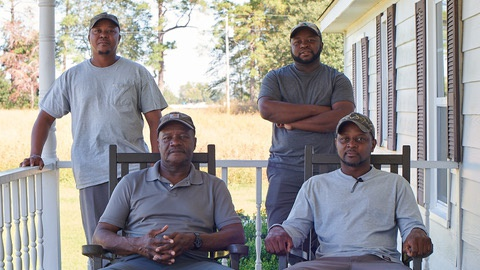 O'Neal Bluefort (bottom right) found it too expensive to grow tobacco and moved on to cotton, corn, and soybeans. Along with his father and two brothers, he operates Blueforts' Farms in Nesmith, South Carolina.