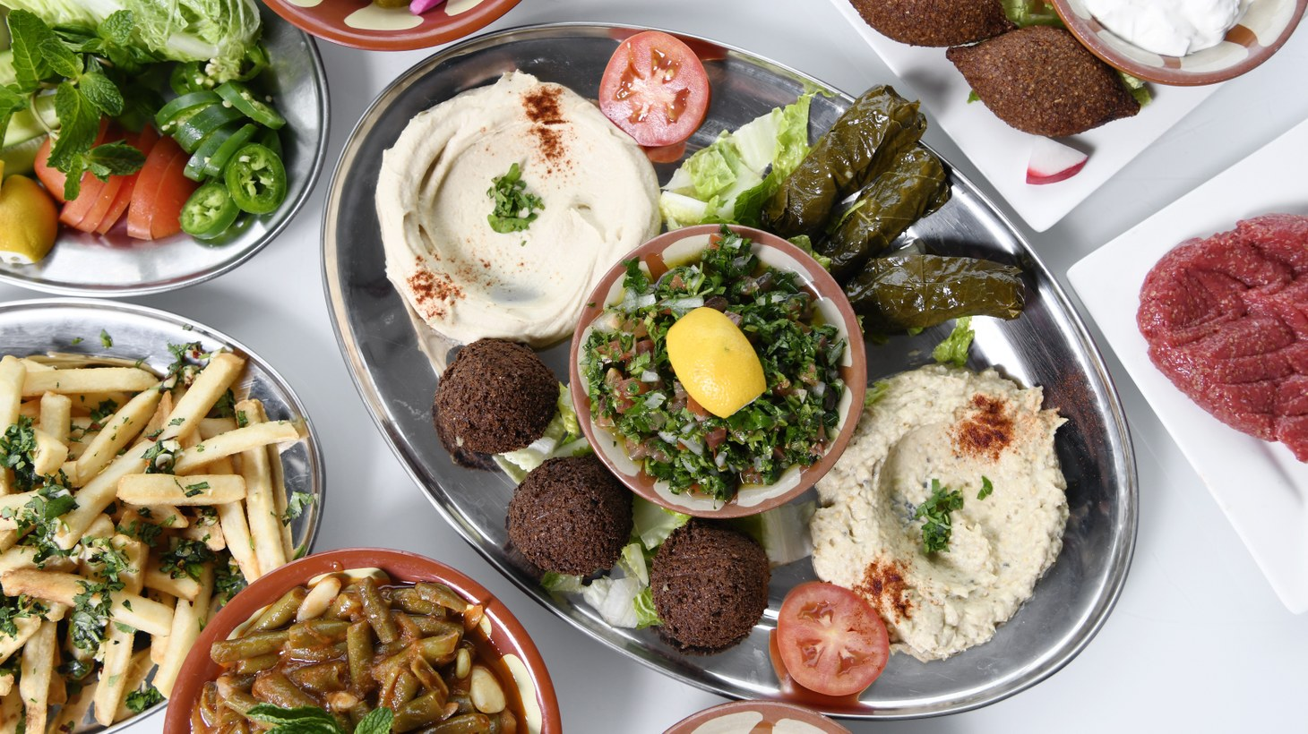 A feast at Hayat's Kitchen often includes falafel, hummus and beef specialties.