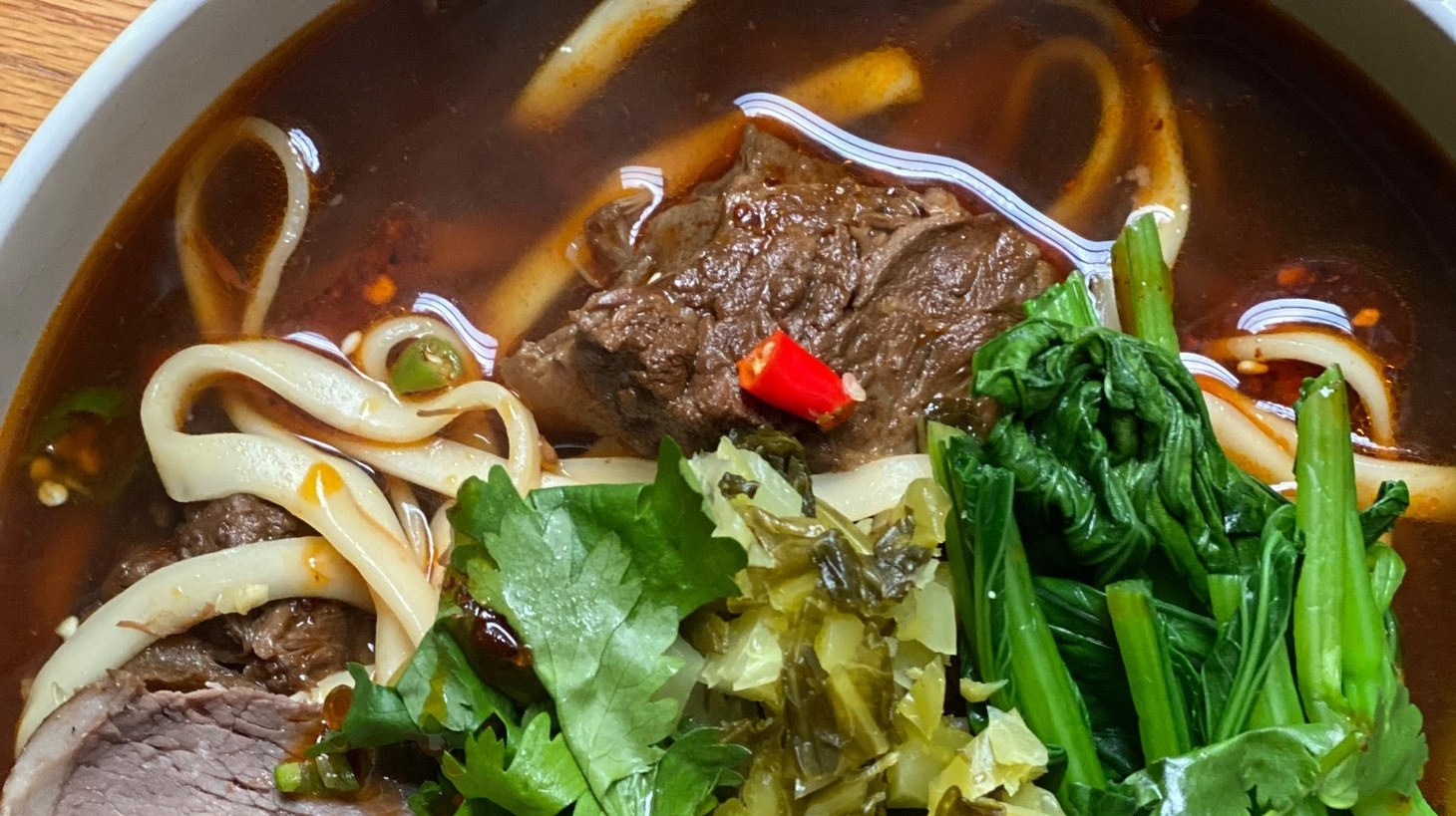 Beef noodles from Yilan Foods in San Francisco have been one of restaurant critic Soleil Ho's pandemic takeout meals. She describes the efforts her fellow San Franciscans are making to track down the city's best takeout.