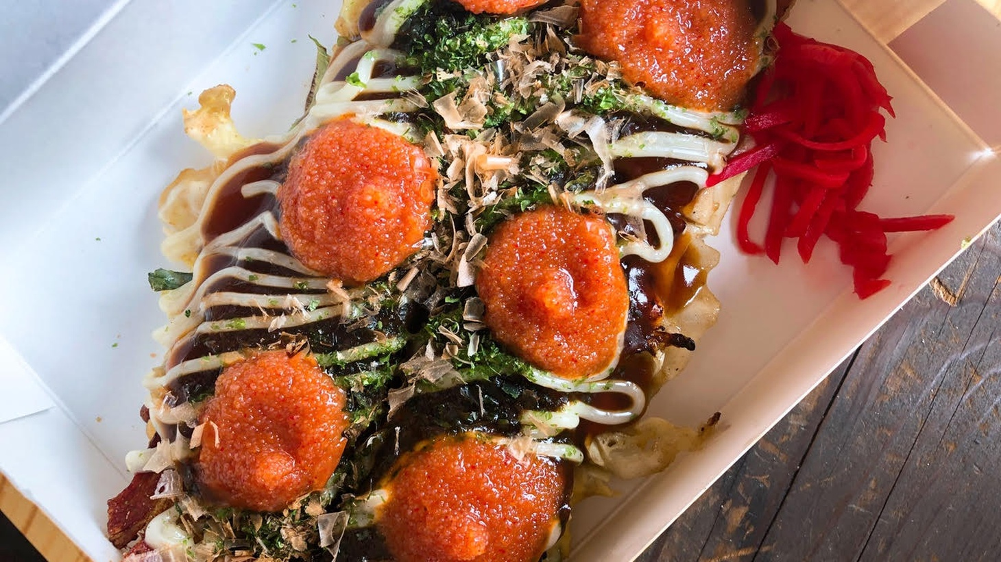 """""""Picking up food takes on the air of a precious chance occurrence like whale watching,"""" says restaurant critic Soleil Ho. Her pandemic takeout in San Francisco includes okonomiyaki from Okkon."""
