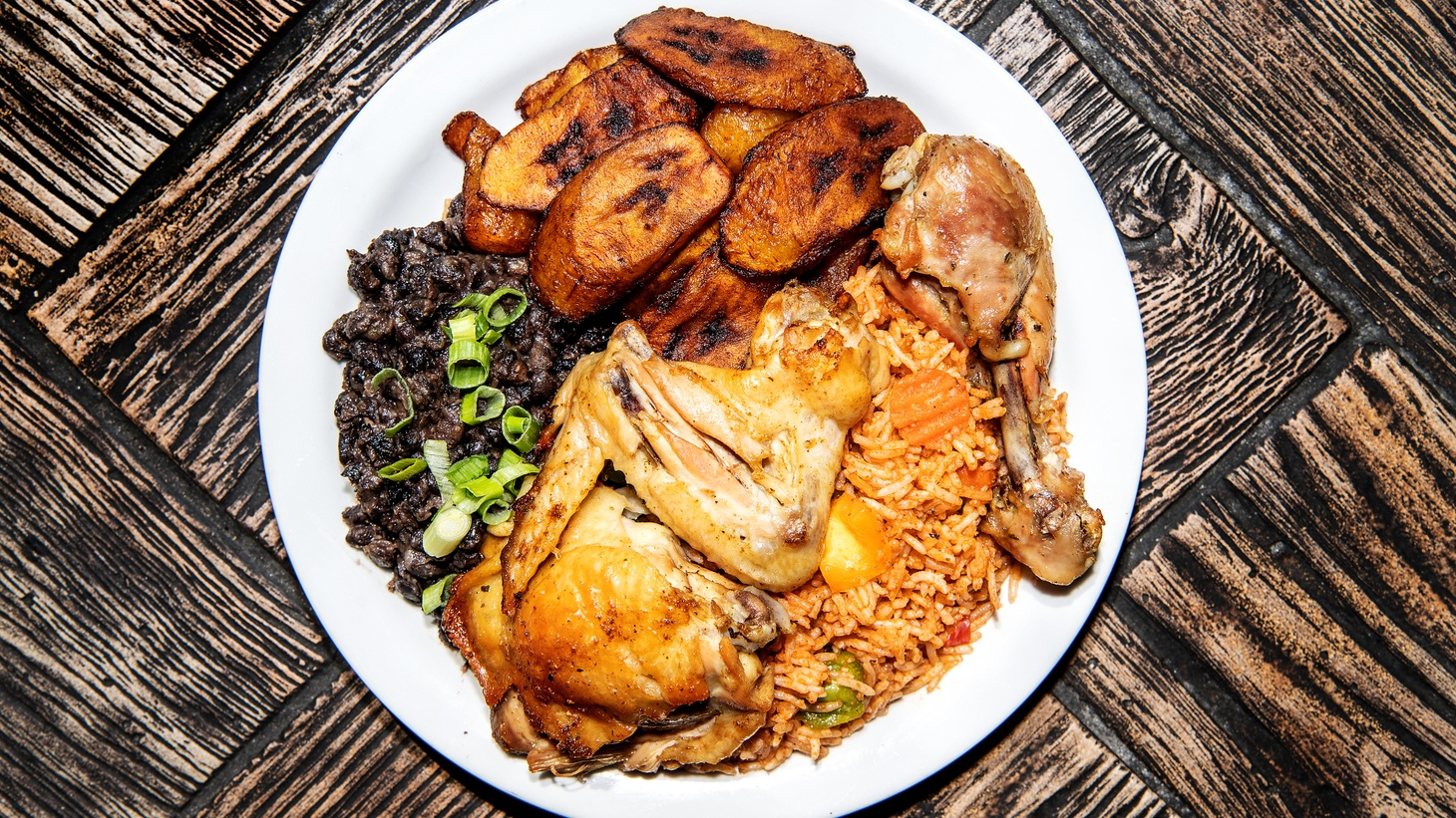 Cameroonian food is based on greens, but LA Times restaurant critic Bill Addison also recommends jollof rice served with plantains and a choice of meat.